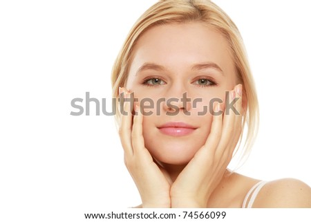 A young woman touching her face