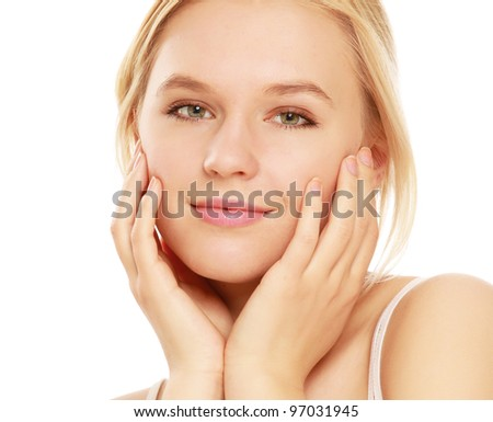 A young woman touching her face , isolated on white background