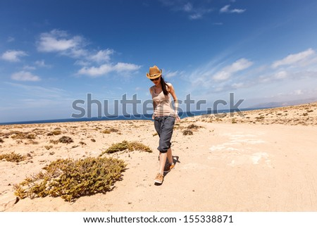 A young woman travels to the island of Fuerteventura - stock photo
