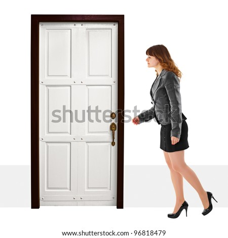 A young woman walks into door on white background