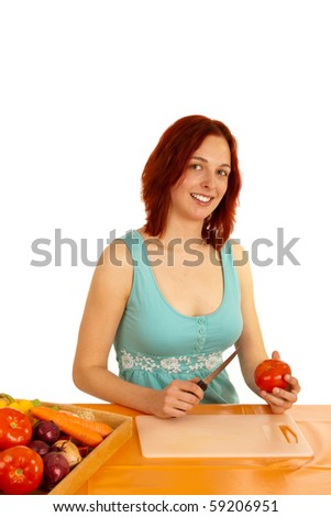 A young woman wants to cut a tomato