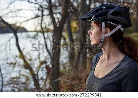 a young woman wearing a bike helmet  - stock photo