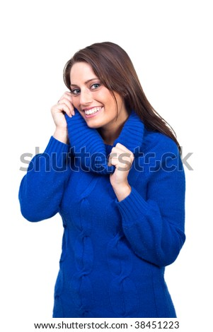 A young woman, wearing a pullover - stock photo