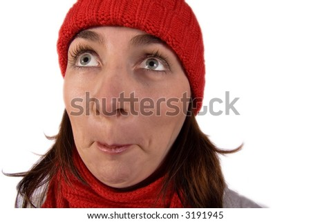 A young woman wearing a red knit cap and scarf looks up with eyes wide open in amazement and incredulity! - stock photo