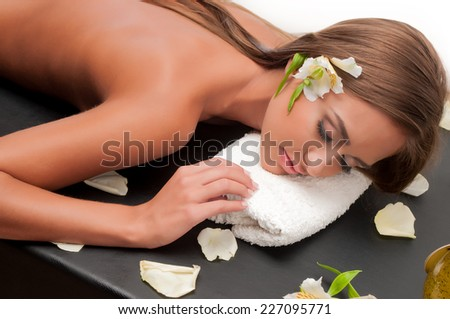 a young woman who does massage cosmetologist - stock photo