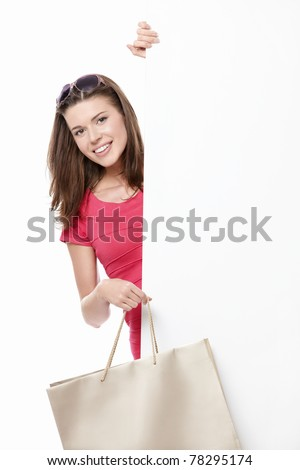 A young woman with a bag and billboards - stock photo