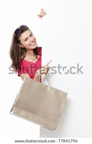 A young woman with a bag of points to advertise - stock photo
