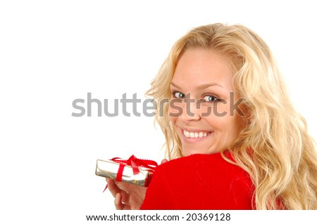 A young woman with a Christmas gift. - stock photo