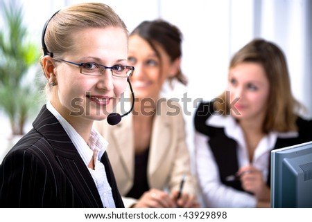 A young woman with a heaset as operator - stock photo