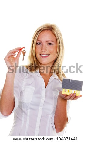 a young woman with a model house and apartment keys. - stock photo