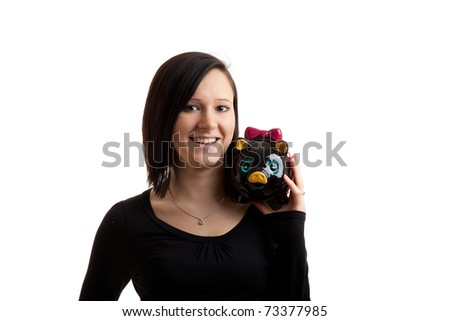 a young woman with a piggy bank on her shoulder isolated on white - stock photo