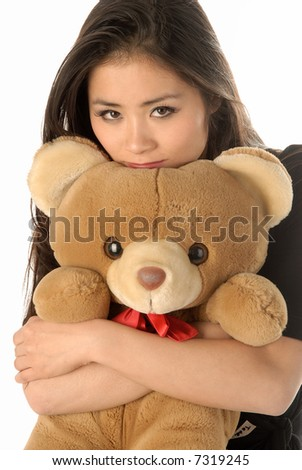 A young woman with a teddybear - stock photo