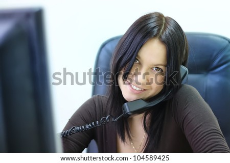 a young woman with a telephone handset - stock photo