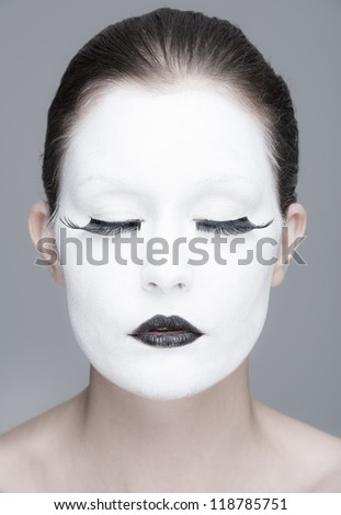 a young woman with a whiteface makeup