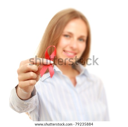 A young woman with an aids ribbon, isolated on white, focus on her hand