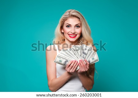 A young woman with dollars in her hands, isolated on white background - stock photo