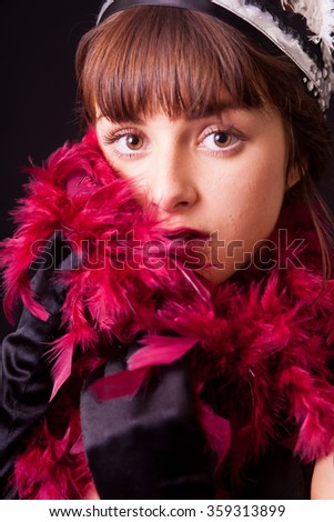 a young woman with feather boa in 20s style - stock photo