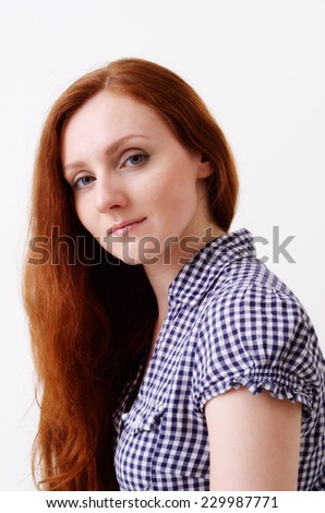 A young woman with ginger long hair