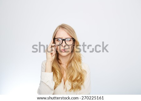 a young woman with nerd glasses. isolated on white.