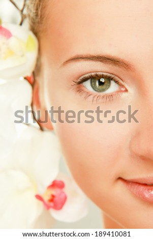 A young woman with orchid, isolated on white background - stock photo