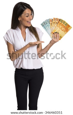 A young woman with real money in her hands, isolated on white background