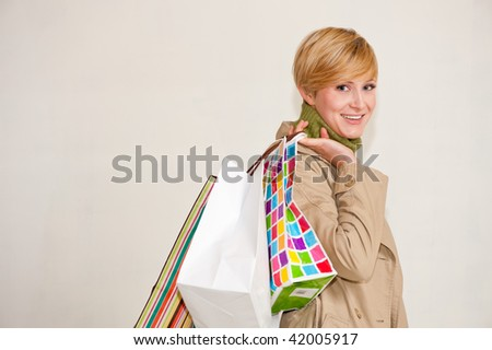 A young woman with shopping bags - stock photo