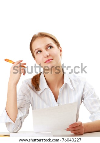 A young woman working, looking up - stock photo