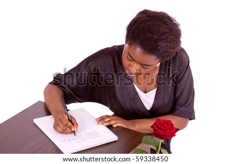 A young woman writes a letter - stock photo