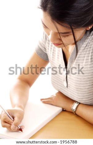A young woman writing on paper