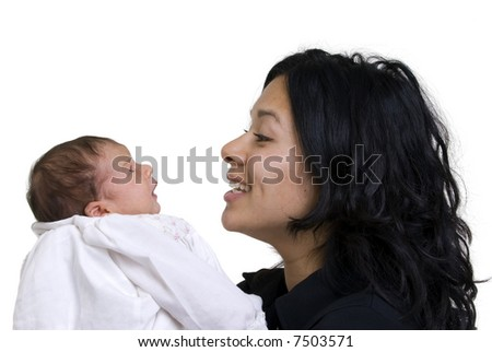 A young women with a newborn girl. Family, love, caring. - stock photo