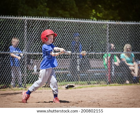 A youth baseball player takes a nice swing at the ball - stock photo
