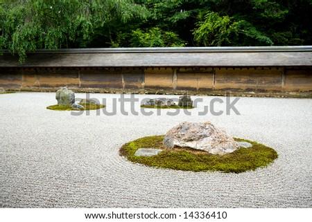 A Zen Rock Garden in Ryoanji Temple.In a garden fifteen stones on white gravel. Kyoto.Japan. - stock photo