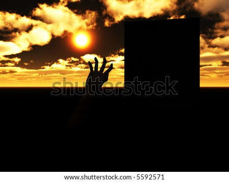 A zombie hand emerging from the ground next to its grave. - stock photo