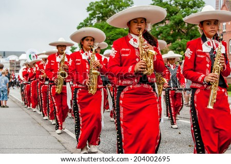 AABENRAA, DENMARK - JULY 6 - 2014: Mexican flute orchestra is marching down the street at the annual tilting festival in Aabenraa
