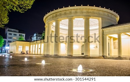 AACHEN, GERMANY, APRIL 11, 2014: People are sitting in front of illuminated elisenbrunnen in german Aachen.