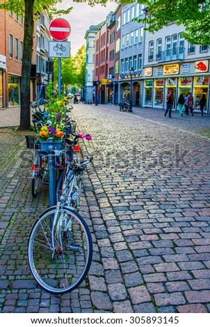 AACHEN, GERMANY, APRIL 10, 2014: view of one of many small streets situated in the historical center of german city Aachen.