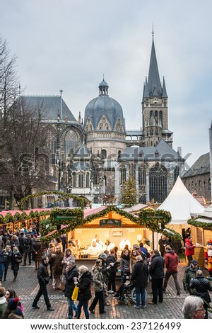AACHEN, GERMANY - DECEMBER 6, 2014: Christmas market in Aachen near the Cathedral. Aachen is a city with population of 260,000 in North Rhine-Westphalia. - stock photo