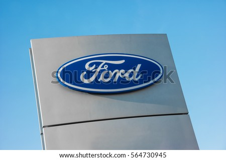 AACHEN GERMANY JANUARY 2017 Ford Dealer Sign Against Blue Sky The