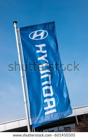 AACHEN, GERMANY MARCH, 2017: Hyundai flag against blue sky. Hyundai Motor Company is a South Korean multinational automotive manufacturer founded at 1967.