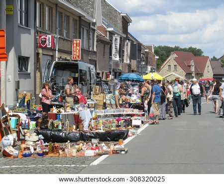 AALST, BELGIUM, AUGUST 16 2015: Flea Market in the streets of Herdersem near Aalst. A type of bazaar, it has become a popular pastime to sell merchandise at or visit to buy secondhand goods.