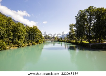 Aare River flows through the green areas of the city Interlaken