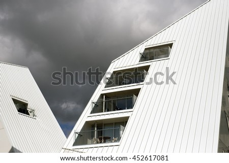 AARHUS, DENMARK - JULY 13, 2016: New modern architecture on Aarhus harbor. The buildings called The Iceberg. Aarhus will be European capital of culture in 2017. July 13, 2016. - stock photo