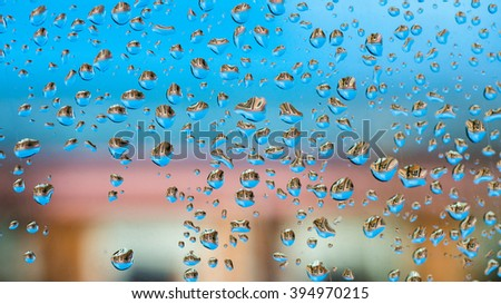 ababstract background with water drops and distorted Windows of the houses - stock photo