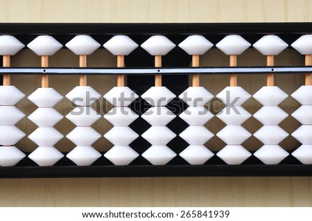 Abacus On Wooden Table  - stock photo