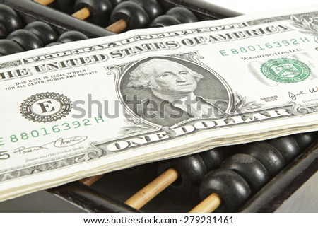 Abacus with dollar on isolate white - stock photo