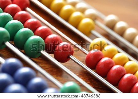 Abacus with multi colored beads - concept for education or calculating - stock photo