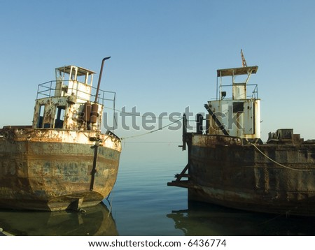 abandon old rusty ships in the coast line - stock photo