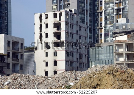 Abandon residnetial house and new residential buildings in Futian district, Shenzhen city, China. - stock photo