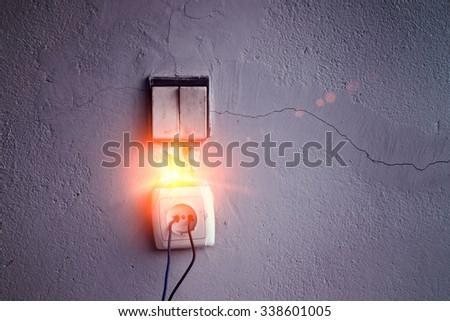 abandon wiring socket with short circuit - stock photo
