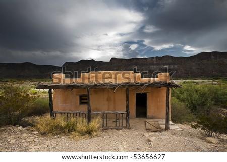 Abandoned adobe house - stock photo